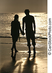 Couple on sunset. Coast of the Indian ocean