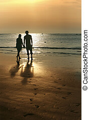Couple on sunset Coast of the Indian ocean