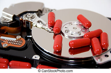 Disk Drive Remedy - An exposed hard drive with some red...