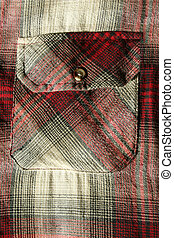 Red flannel shirt pocket - A close up of a Red flannel shirt...