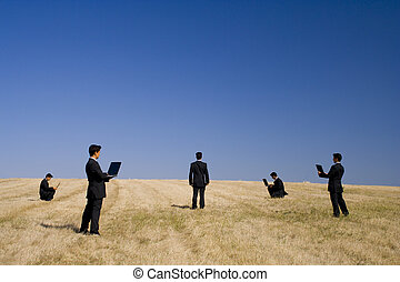Nature partner - businessman working in a field making a...