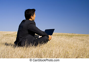 Working in and with the nature - a business man working in...