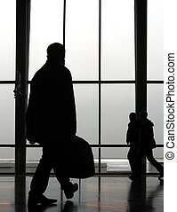 Traveller 2 - Travellers at an airport, walking to next gate