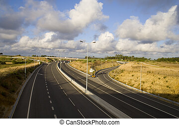 highway on cloudy day - a perspective of a highway with a...