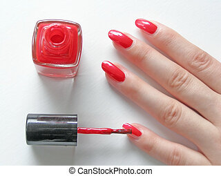 manicure - woman\\\'s nails with manicure and vial of red...
