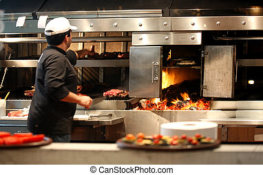Chef at work - Argentinian chef cooking meat in the...