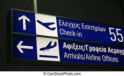 Athens check-in - A sign board for check-in desks and the...