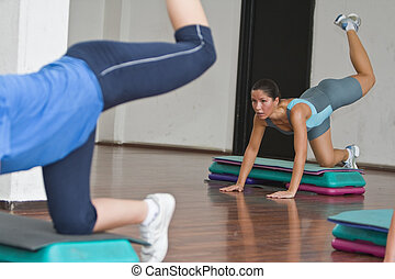 Aerobics action - Aspect from an aerobics class in a fitness...