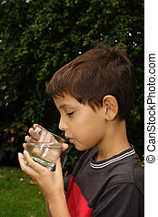 Thirst - Child drinking a glass of fresh water