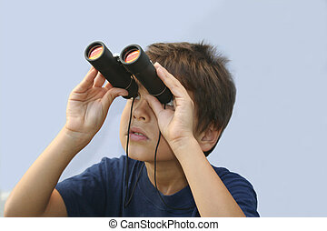 Binoculars - Young boy looking through the binoculars