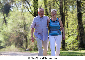 Happy seniors - Happy elderly couple out for a walk in the...