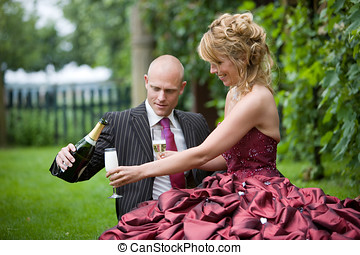 Wedding toast - Groom pouring his new wife a glass of...