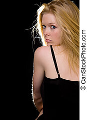 Looking over shoulder - Attractive woman with long blond...