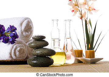 Spa products - spa products with stones towels flasks and...