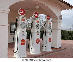 Vintage gas pumps - Three vintage gas pumps