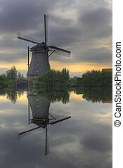 Windmill in the Mirror - Windmill perfectly mirrored in...