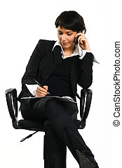 girl calls - The serious business girl sits in an armchair...