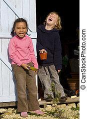 Gardening Fun - Two young children having fun in the garden