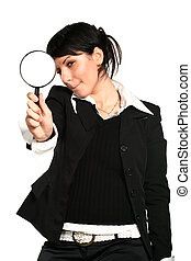 search - The girl searches for something through a magnifier...