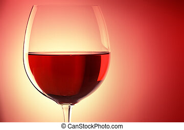 glass of red wine, backlited, with space for text
