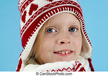 Winter girl - Little blond girl wearing woolen cap, scarf...