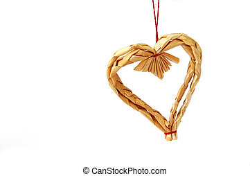 Christmas decoration - heart made of straw; close-up,...