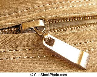 fastener - On half unfastened metallic zipperr close-up
