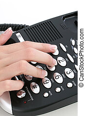Telephone - Womans hand on telephone
