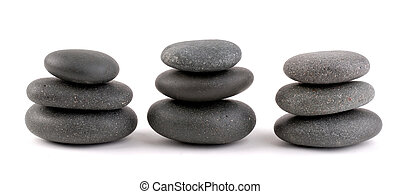 Spa Stones Piled Up In Three\\\'s, Isolated On A White...