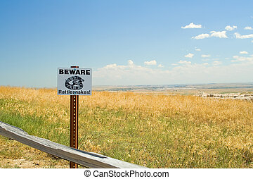 Beware of Rattlesnakes sign in The Badlands National Park.