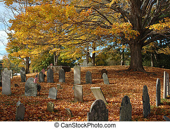 Old Cemetery in October - Old New England cemetery under a...