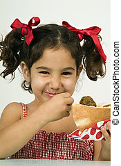 girl eating falafel - young happy Israeli girl eating...