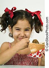 girl eating falafel - young happy Israeli girl eating...