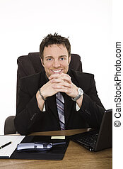 Businessman - Caucasian businessman setting at a desk...