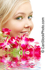 lovely blond with orchid in water - bright picture of lovely...