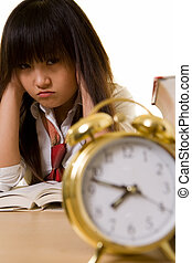 Time management - Young Chinese girl wearing school uniform...