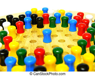All Alone - A blue peg on a chinese checkers board...