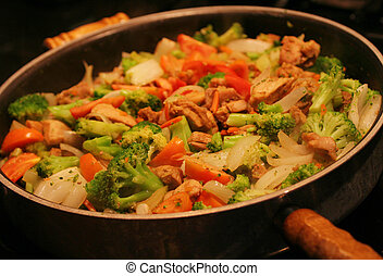 Stir Fry in wok - Stir fry of chicken,...