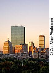 boston sunrise - the warm color of the sun bathes the boston...