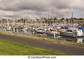 Approaching Storm - Nice yachts at a marina under a stormy...
