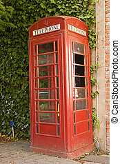 Red Booth - A red telephone booth on a street corner