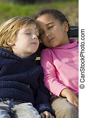 Sleeping In The Garden - Two young children, one a blond boy...