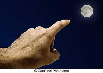 Full Moon - Mans Hand pointing the moon