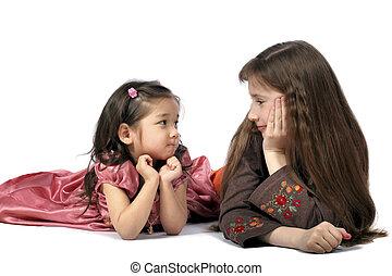 Two girls look friend on friend