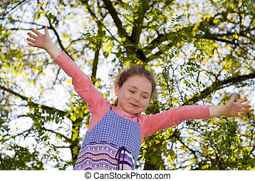 girl at playground, balancing on beam, looking at up,...