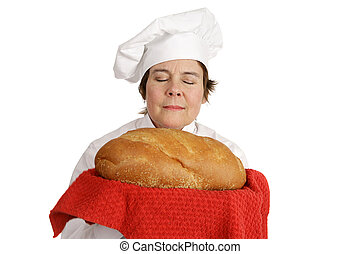 Chef Series - Aroma of Bread - Female chef inhaling the...