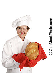 Chef Series - Italian Bread - Cute female chef holding up a...