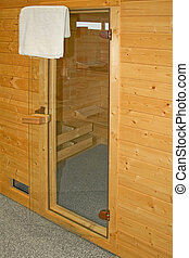 Sauna entrance - Glass door of new home wooden sauna