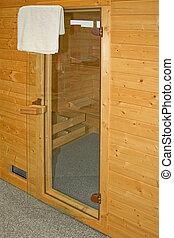 Sauna entrance - Glass door of new home wooden sauna