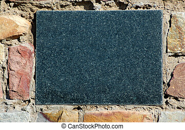 Blank sign - A blank dark grey granite sign in an old stone...